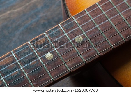 six strings on an old worn guitar