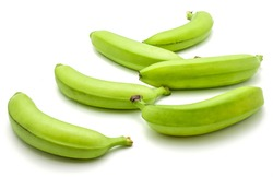 Six whole plantain isolated on white background separated green bananas
