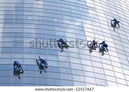 Six window washers - stock photo