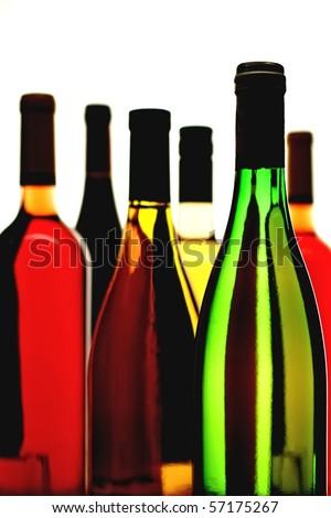 Six wine bottles on a white background.
