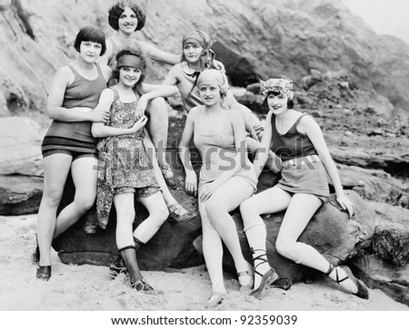 Six women posing at the beach - stock photo