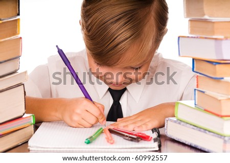 Six years boy writing in the notebook