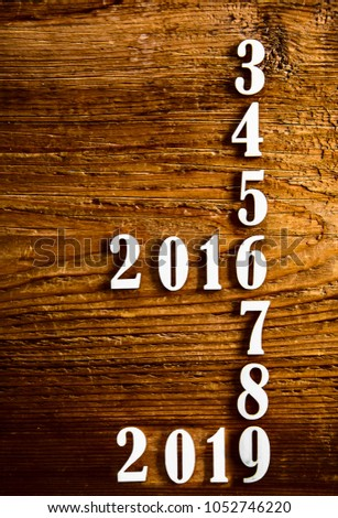 Six years in the future from 2013, 2014, 2015, 2016, 2017, 2018, 2019 on wooden table calendar background #1052746220