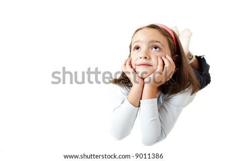 Six years old girl dreaming or thinking isolated on white background