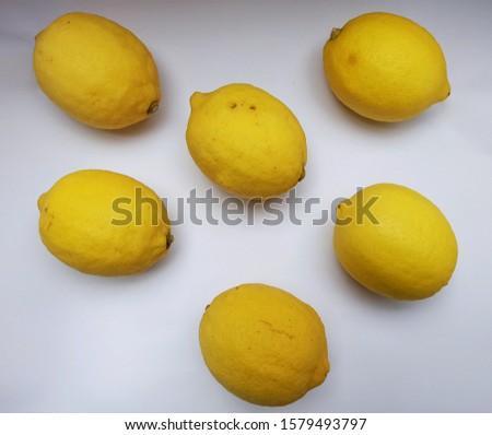 Six yellow lemons taste sour.