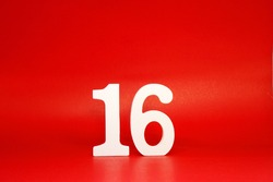 Sixteen ( 16 ) white number wooden on Red Background with Copy Space - New promotion 16% Percentage  Business finance Concept