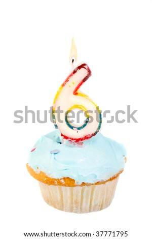 sixth birthday cupcake with blue frosting on a white background