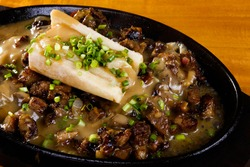 Sizzling beef with bone marrow