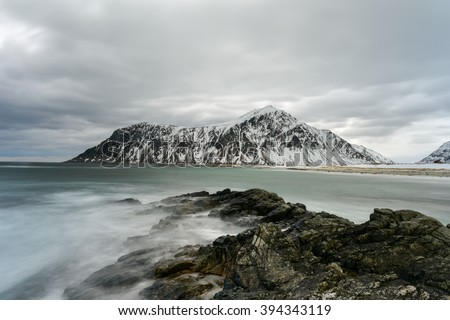 Skagsanden Beach in the Lofoten Islands, Norway in the winter on a cloudy day. #394343119