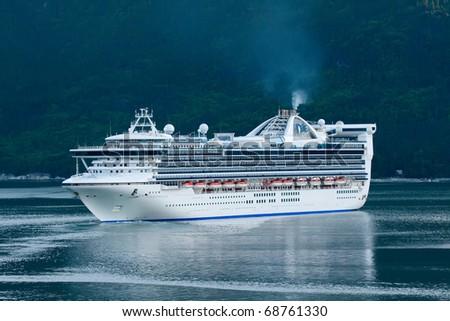 SKAGWAY, ALASKA - JUNE 3:  Cruise ship prepares to enter port in Skagway, Alaska on June 3, 2009.