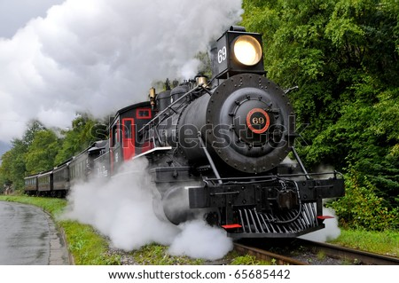 SKAGWAY, ALASKA - SEPT 7: Restored steam train of White Pass & Yukon RR runs as visitor attraction on Sept 7, 2008 in Skagway, Alaska - stock photo