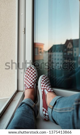 Skate guy sitting at the window drinking coffee skating on the street with fashion and lifestyle matthias dengler snapshopped wearing sneakers shoes in urban style and fashion lifestyle nürnberg