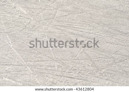 stock-photo-skate-marks-on-the-ice-surface-of-an-ice-rink-43612804.jpg