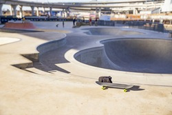 skateboard and backpack in skate park. the concept of freestyle extreme sport. empty space for your text
