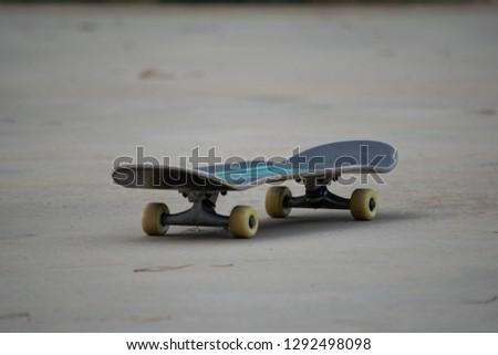 Skateboard lying on ground #1292498098