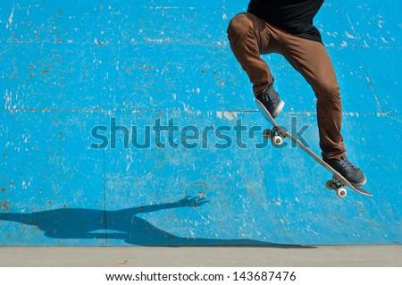 Skateboarder doing a skateboard trick - ollie - at skate park.