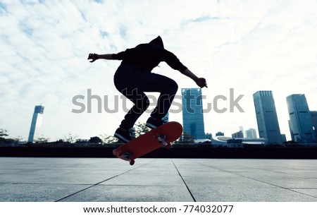 Skateboarder doing a trick named ollie on city with skateboard #774032077