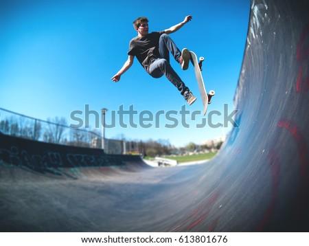 Skateboarder doing ollie on ramp