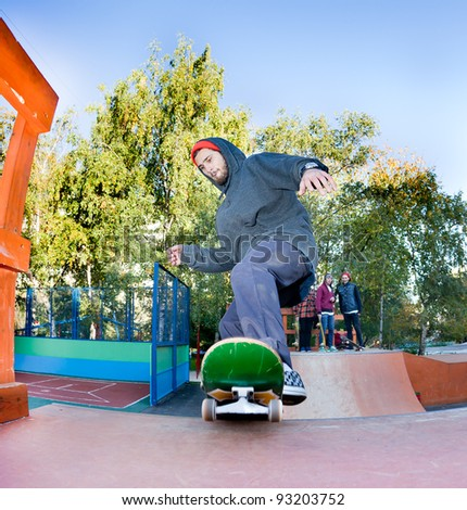 Skateboarder jumping in the halfpipe