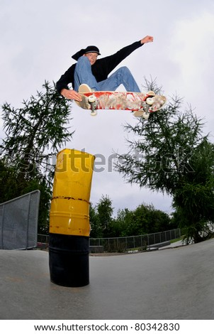 skateboarder jumping very high at the skatepark.slight motion blurr.