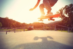 skateboarder legs riding skateboard at skatepark,vintage effect