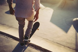 Skateboarder portrait ready to go at skate park. Sunset light, life style.