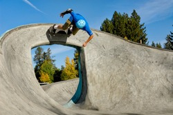 Skateboarder Rides over Arch