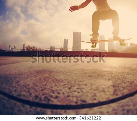 skateboarder skateboarding at  city #341621222