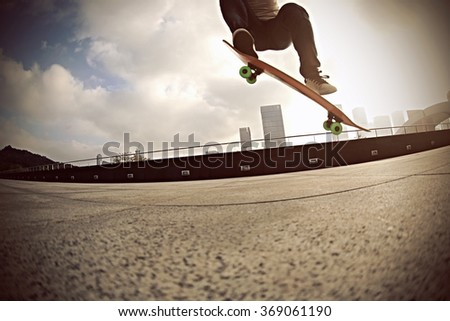 skateboarder skateboarding at city #369061190