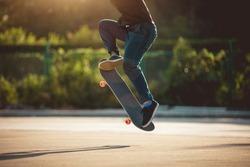 Skateboarder skateboarding at morning outdoors