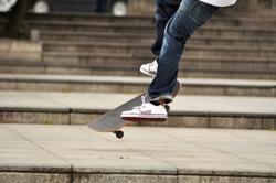 Skateboarder skateboarding in the park. Skater in action. Outdoor sport activity. Energetic boy skating.