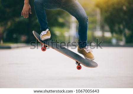 Skateboarder skateboarding  on parking lot - Shutterstock ID 1067005643