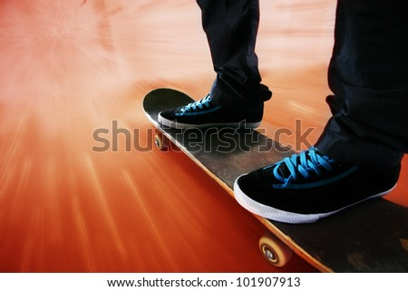 skateboarding- blurred movement - stock photo