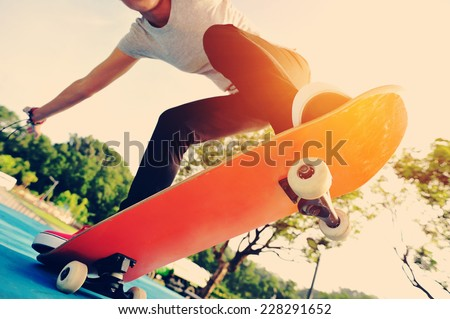 skateboarding woman at skatepark