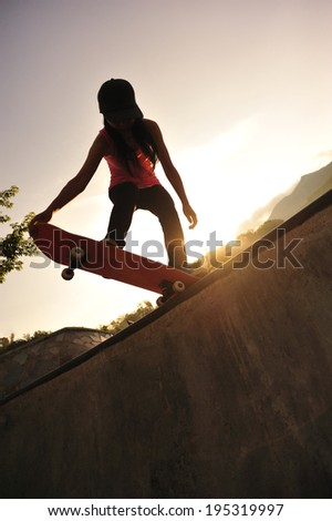 skateboarding woman at sunrise skatepark #195319997