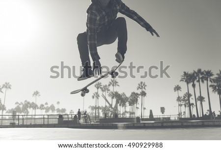 Skater boy practicing at the skate park #490929988
