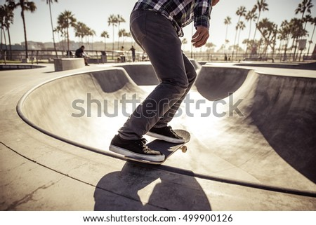 Skater boy practicing at the skate park #499900126