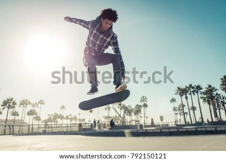 Skater boy practicing at the skate park #792150121