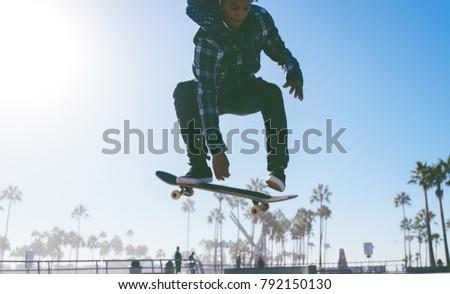 Skater boy practicing at the skate park #792150130