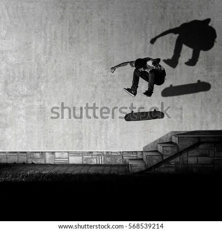 Skater making 360 flip trick from 4 stairs - artistic motion blur shot in black and white color tone.