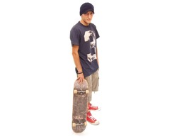 skater posing with a skateboard on white background