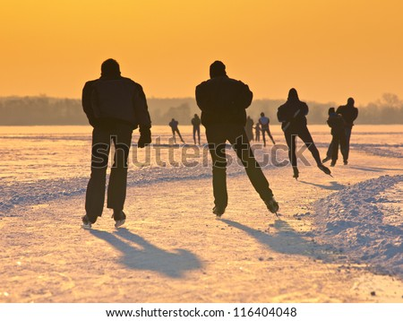 Skaters on a dutch lake seen on their back during the eleven cities tour