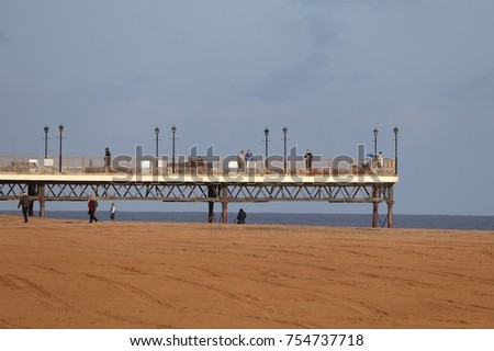 Skegness pleasure beach pier autumn skyline #754737718