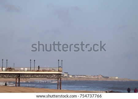 Skegness pleasure beach pier autumn skyline #754737766
