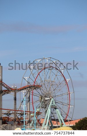 Skegness pleasure beach pier autumn skyline #754737844