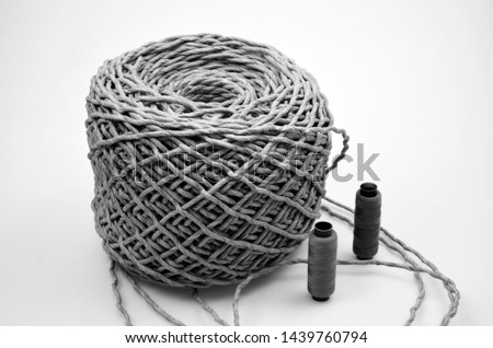 Skein of jute twine and two thread spools on a white background. #1439760794