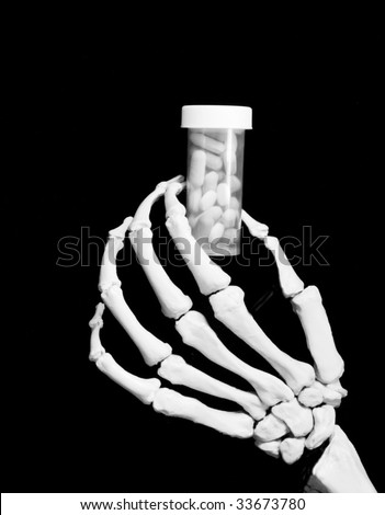 skeletal hand holding prescription bottle