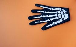 skeletal hand like a halloween glove