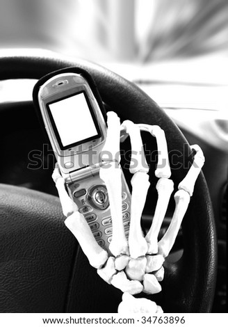 skeletal hand texting while driving