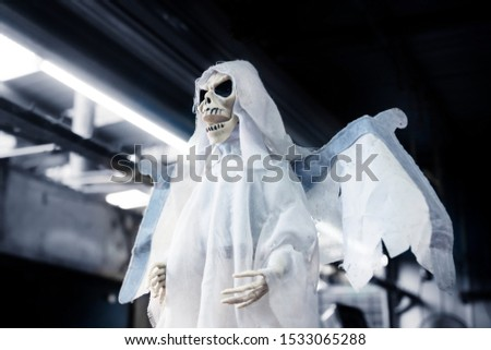 Skeleton ghost puppet as decoration for halloween, day of the dead with industrial background in Merida, Mexico #1533065288